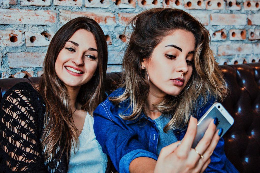 Girls taking selfie for instagram